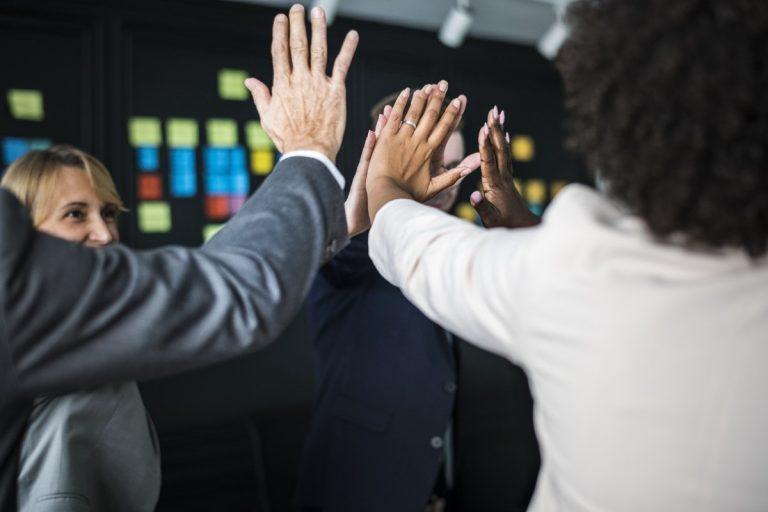 What goals do businesses achieve through team building?